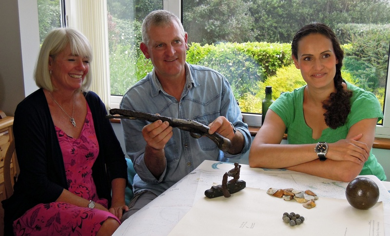 Todd and Carmen Stevens with a flintlock pistol from the wreck site