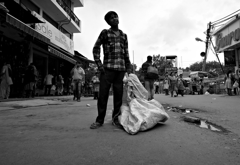 4 Baadshah, with his ragpicking sack.  He works ten hours a day collecting recyclable rubbish from the streets