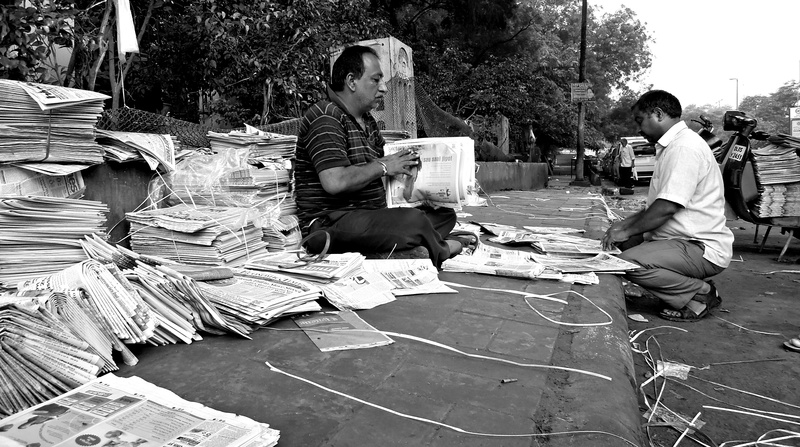 44 Delhi newspapermen bundle thousands of newspapers every morning. Most are in English or Hindi